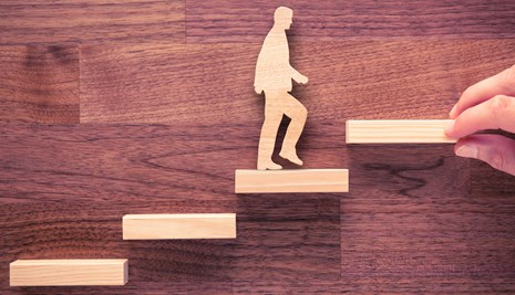 Cut-out man climbing steps