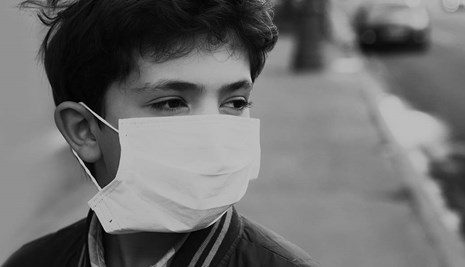 Boy wearing a surgical mask