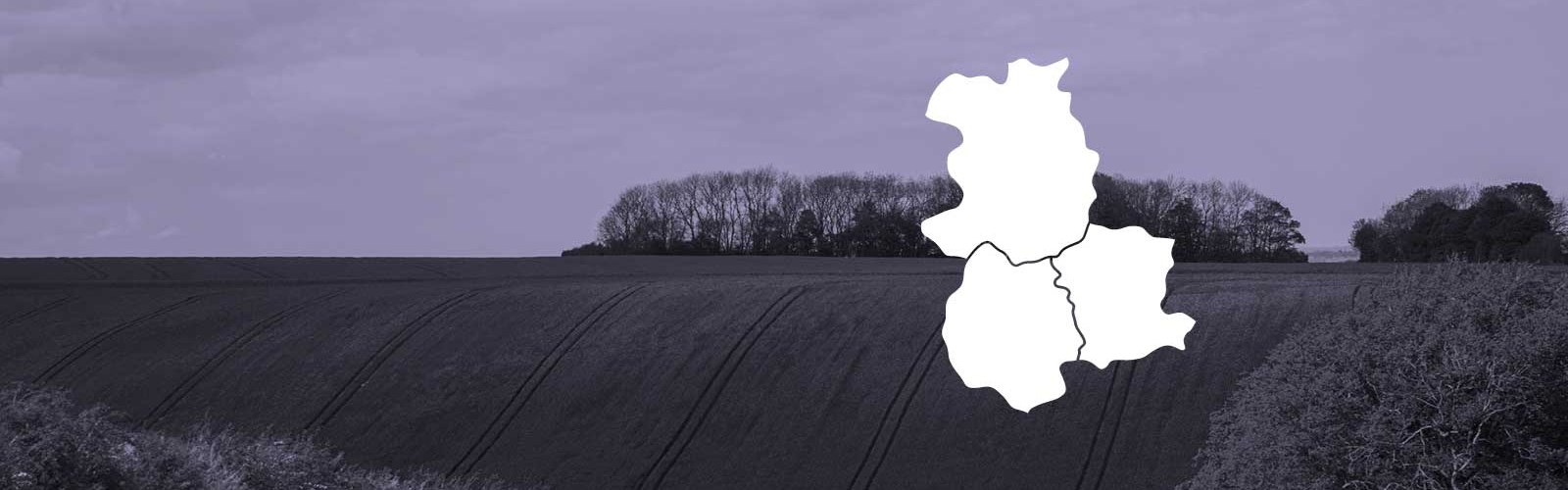 Photo of the countryside with a white map of Hereford, Shropshire and Worcestershire