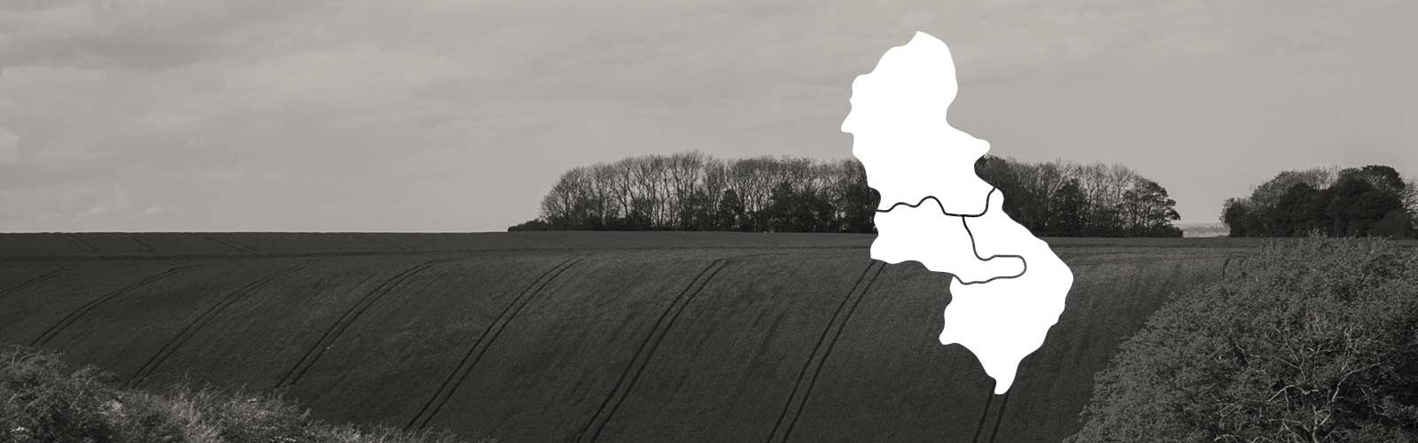 Photo of the countryside with a white map of West Midlands