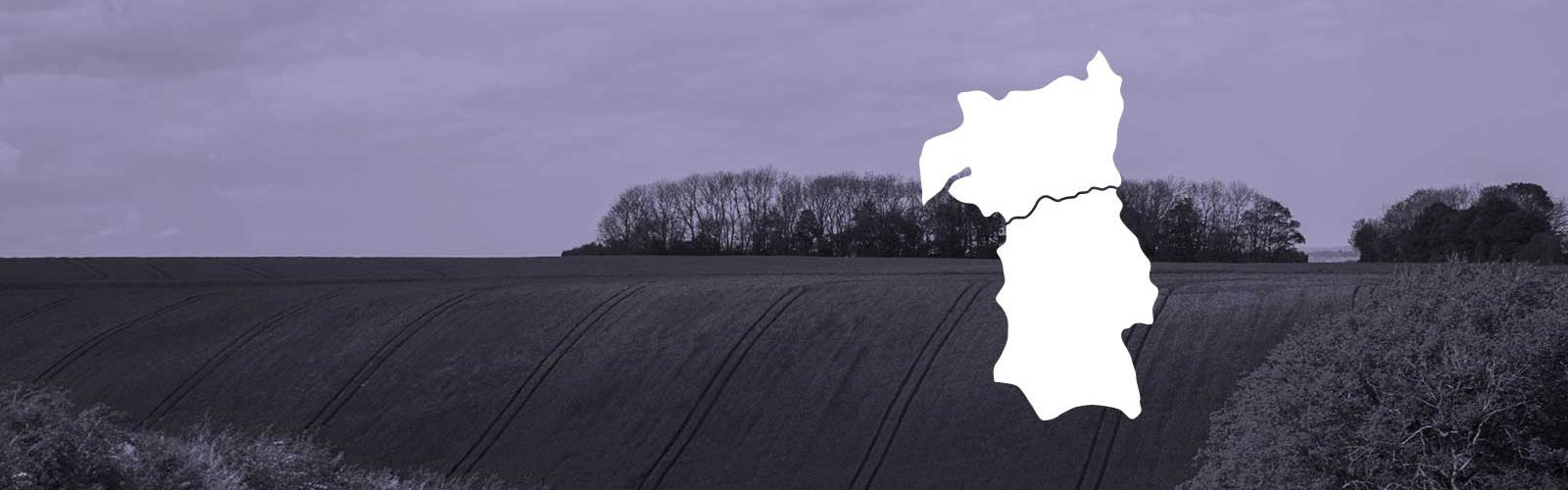 Photo of the countryside with a white map of West of England region