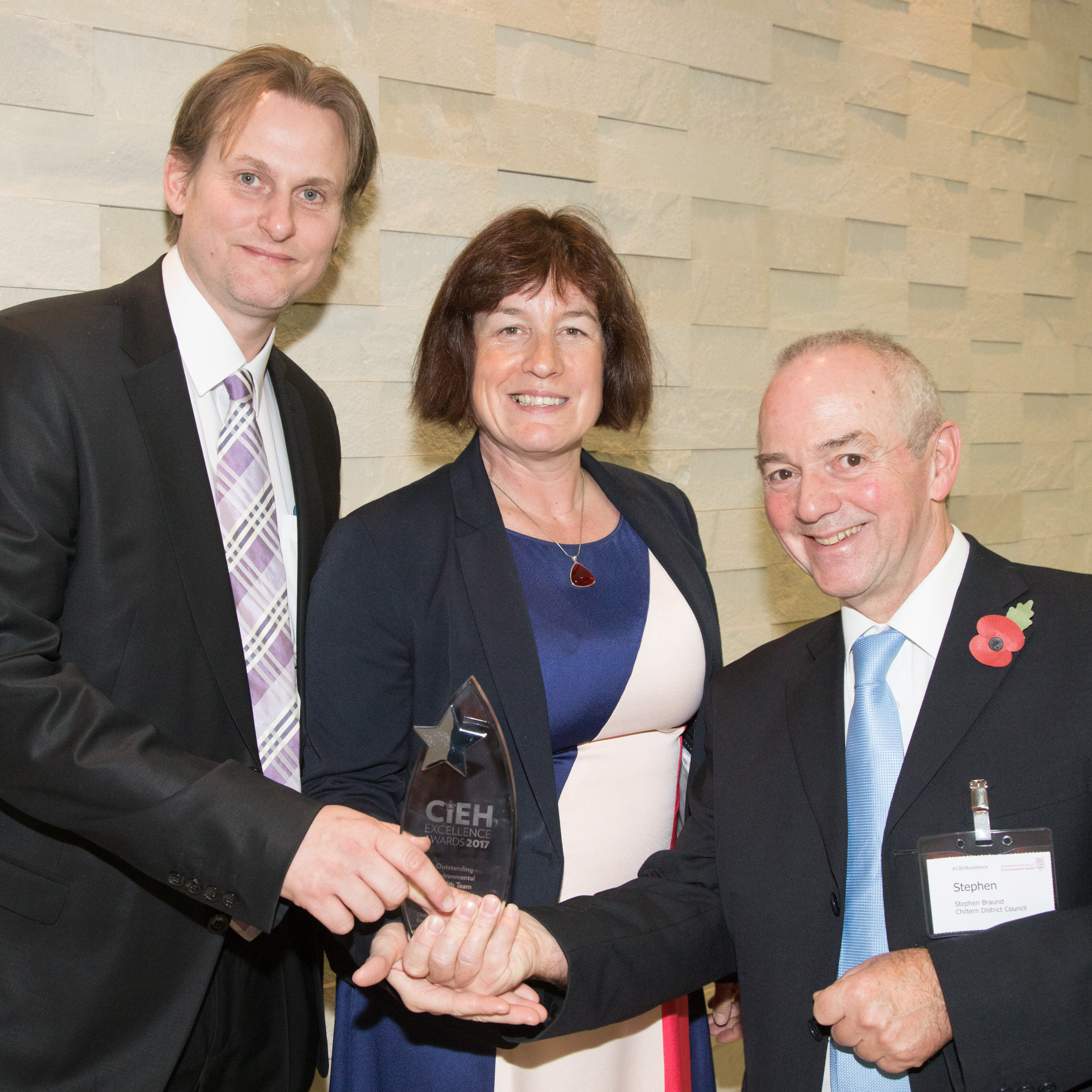 CIEH Excellence Awards winners hold trophy