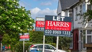 Estate agent signs advertising homes for rent