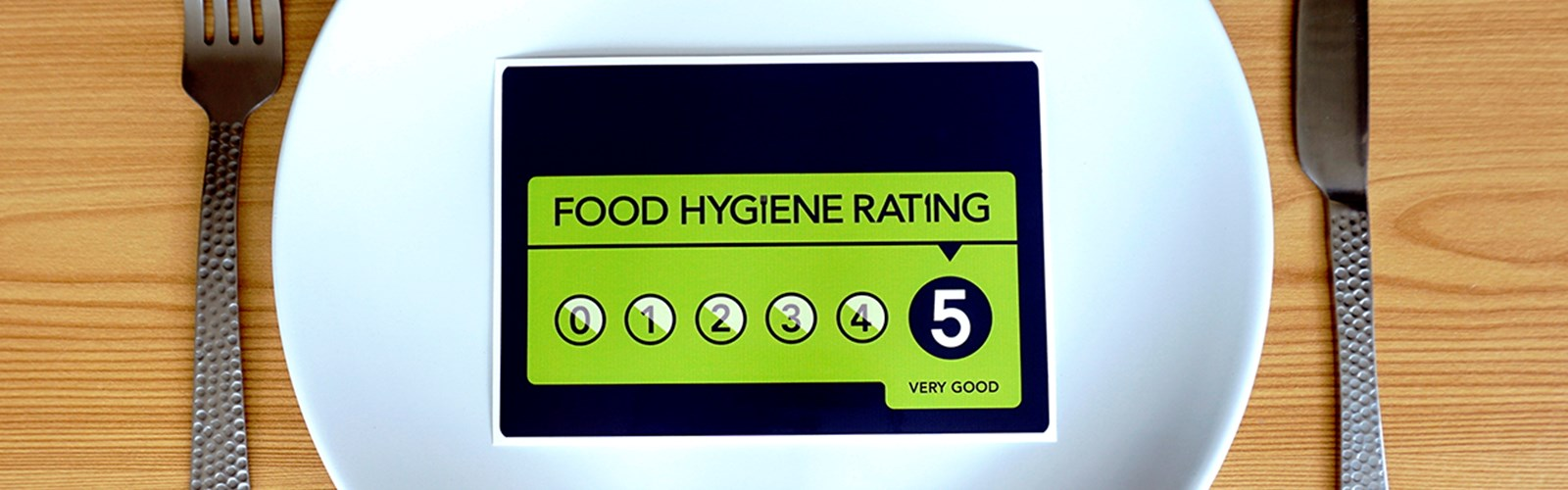 Food Hygiene Rating card on a plate