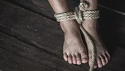 Feet tied up with rope