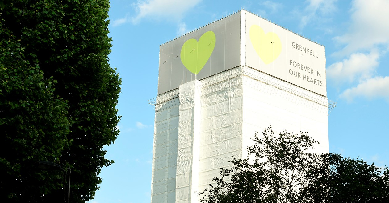 Grenfell Tower clad in white sheeting after the fire