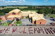 Aerial shot of schoolchildren standing together to form the words 'We love clean air'