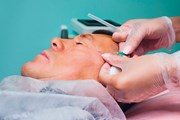 A person undergoing a cosmetic facial treatment