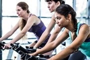 People on exercise bikes: research has found benefits of labelling food with how long it would take to burn off calories consumed