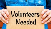 Sign that says 'Volunteers Needed'