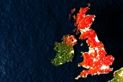 Satellite view of the United Kingdom, with Great Britain and Northern Ireland coloured red