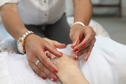 Patient receives acupuncture therapy on her hand