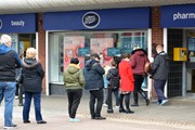 A queue of people outside a Boots