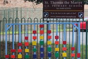 Up Holland, West Lancashire, UK: wooden rainbow blocks on a school gate in support of the NHS