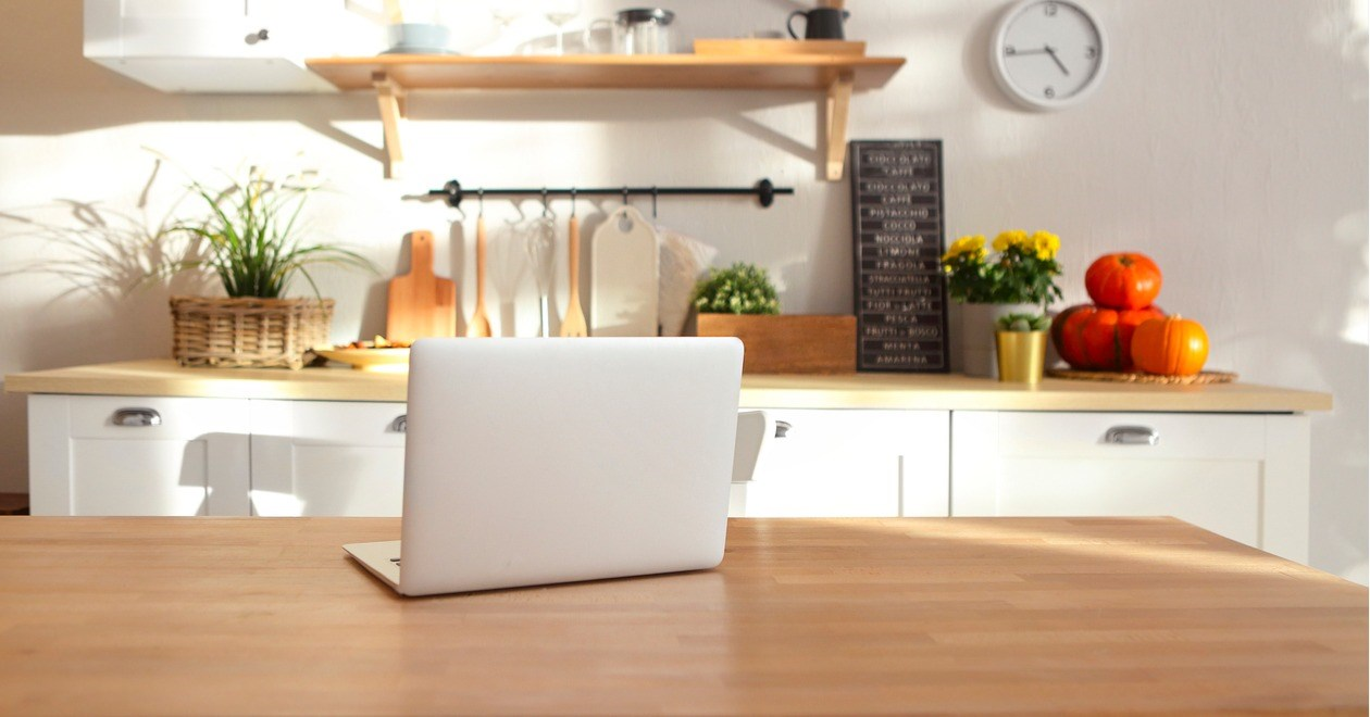 Laptop on a kitchen workbench