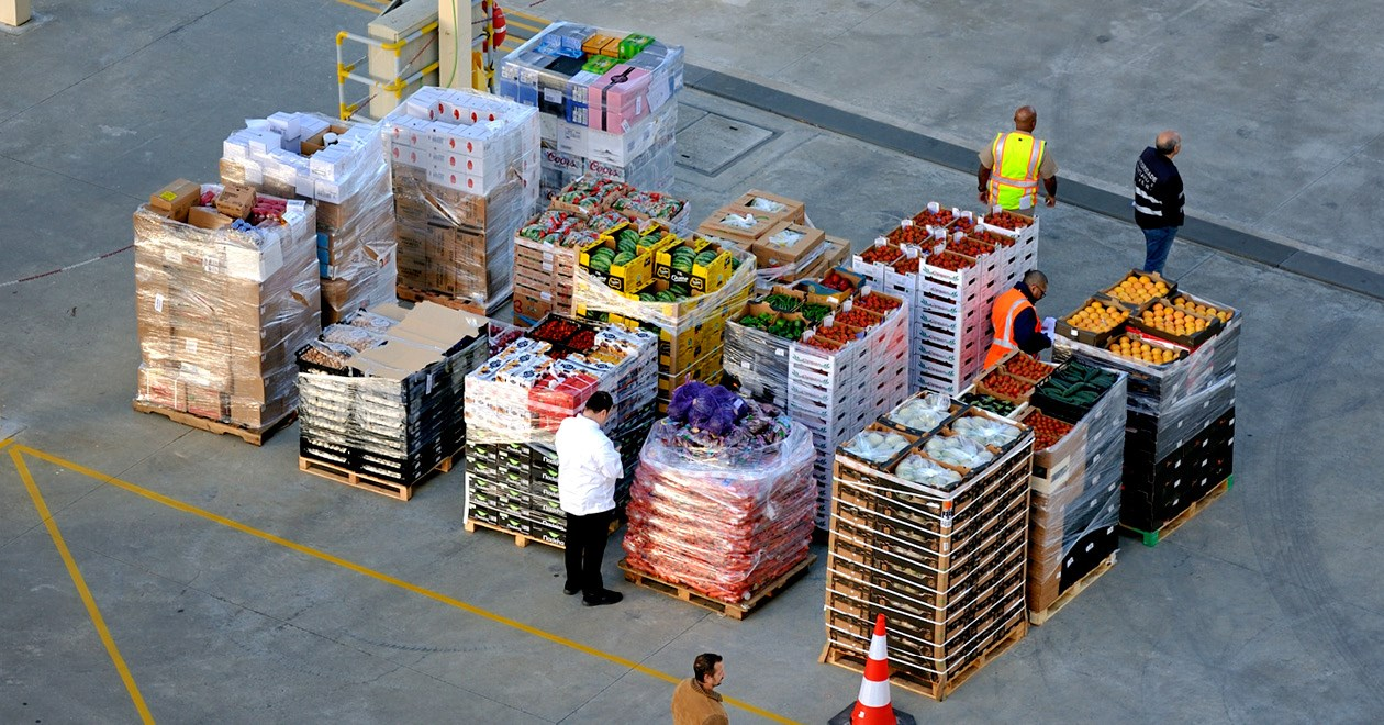 Food in crates being inspected in a port health warehouse