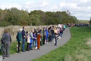 Environmental activists at Rimrose Valley in Liverpool (A5036) make a long line down a path