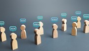 Wooden people icons with speech bubbles