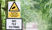 No Fly Tipping sign with trees in background